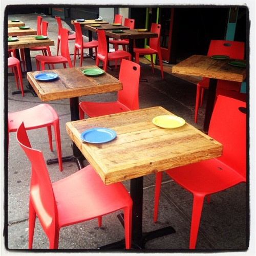 Eye-catching, memorable outdoor tables and plates at 9:45 am, well before opening time, at the newish Amigos Restaurant on 113th  St and Broadway. #columbiapix #nycpix