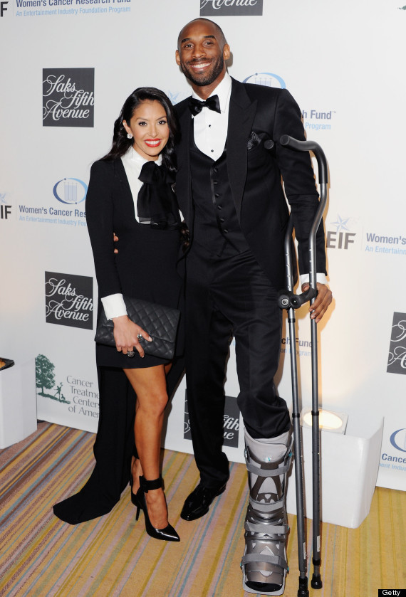 let's face it, Kobe rocks Suit & Tie (& Crutches) better than you or I ever can