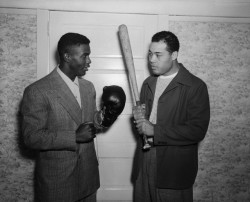 vintageblackglamour:  Jackie Robinson and Joe Louis compare notes, and the tools of their respective trades, on June 14, 1946 during Mr. Robinson's visit to Mr. Louis's training camp in Pompton Lake, New Jersey. It was 66 years ago today, on April 15, 1947, that Jackie Robinson broke the color barrier in Major League Baseball to play with the Brooklyn Dodgers. Photo: Bettman/Corbis.