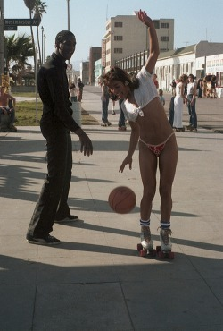 Basketball and rollerskating on Venice Beach, California, 1979.   Pass the ball
