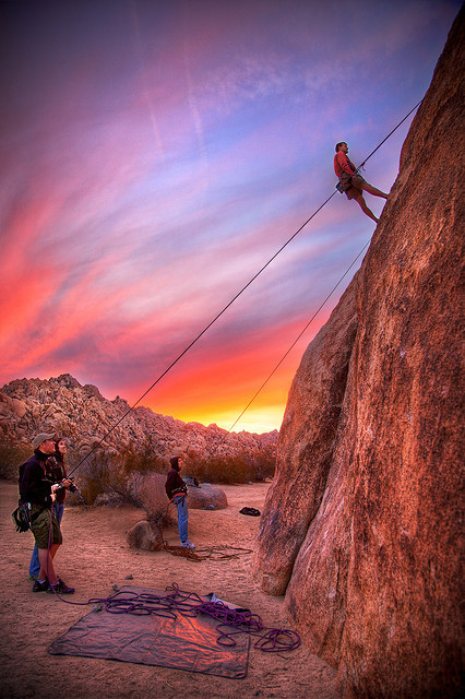 Rock climbing in Indian Cove, Joshua Tree National Park, CA at sunset Photo by Daniel Peckham