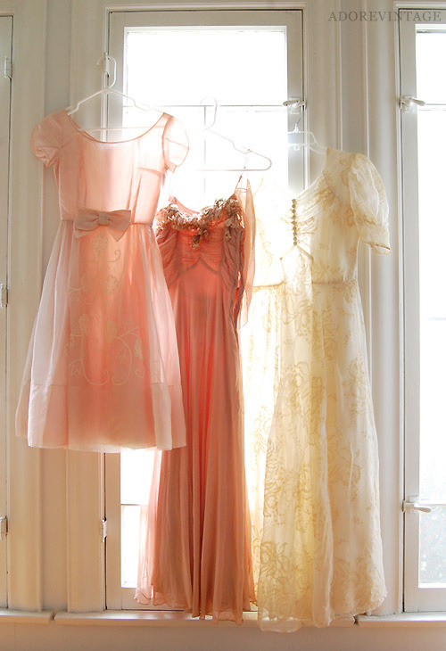 all-things-bright-and-beyootiful:  Vintage dresses in my window ~ by adoredvintage