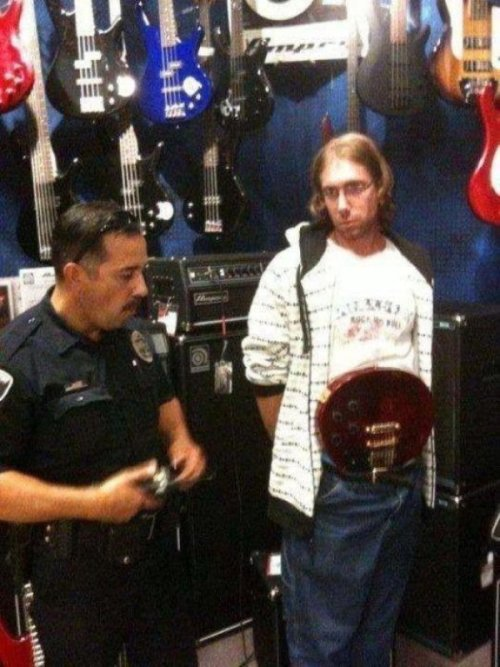 Guy Almost Gets Away With Stealing Guitar His guitar hiding is like his guitar playing: a tight jam.