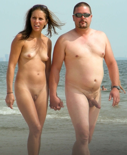 mixedgendernudity:  Happy couple walking nude along the shoreline