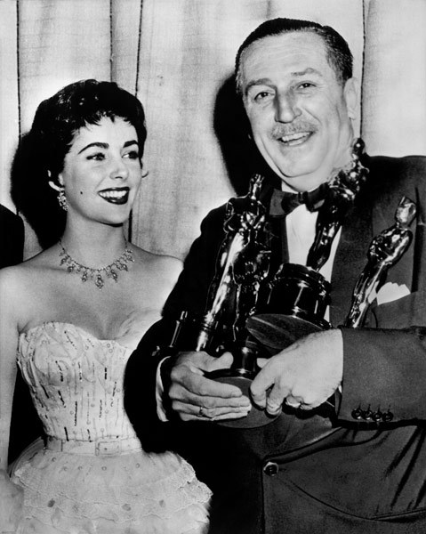 Elizabeth Taylor and Walt Disney at The 26th Academy Awards where Disney was awarded three Oscars.  (1954)