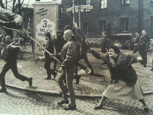 collectivehistory:  A woman hitting a skinhead with her handbag, Sweden, 1985 by Hans Runesson. The woman was reportedly a concentration camp survivor.