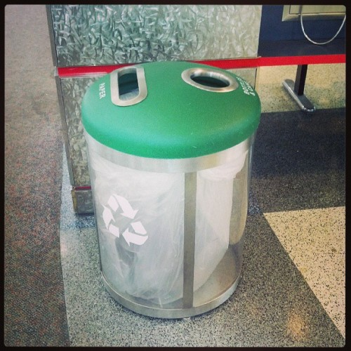 looks legit.. a recycle bin with paper on one side and bottles on the other @ newark airport