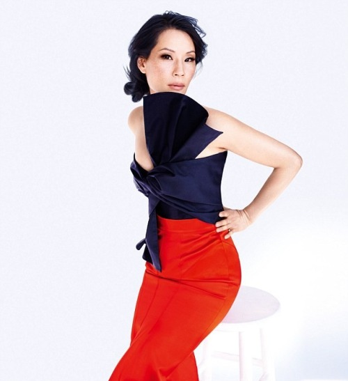 Lucy Liu  in a top by Maison Martin Margiela with a skirt by Burberry Prorsum