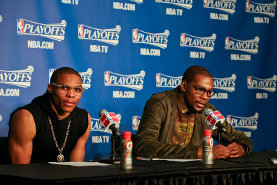 nba:  Russell Westbrook #0 and Kevin Durant #35 of the Oklahoma City Thunder speak to members of the media following their team's victory against the Houston Rockets in Game One of the Western Conference Quarterfinals during the 2013 NBA playoffs on April 21, 2013 at the Chesapeake Energy Arena in Oklahoma City, Oklahoma. (Photo by Layne Murdoch Jr./NBAE via Getty Images)  Sad to see Russ growing out of the Hipster phase, but I'm excited for the Mr.T/80s phase.
