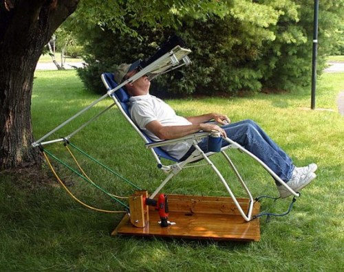 "Is this man relaxing or his he trapped in some sort of backyard ""chair of torture"" inspired by A Clockwork Orange? The answer is neither. It's actually a serious piece of astronomical hardware. This device is a motorized stargazing chair:  ""It has a shelf that places a set of high-power binoculars directly in the user's line of sight. The elevation is easy to adjust. And a power drill lets you take the whole thing for a spin. The base has been outfitted with cogs and a chain from an old bicycle. The gear reduction lets a power drill rotate the platform. This worked well enough but [Gary] found that making fine adjustments was rather difficult and more often than not he ended up moving the binoculars to avoid overshooting when adjusting the platform with the drill. Luckily he didn't give up on the idea. On the eighth and final page of his build log he refines the rotating setup with the help of an ice cream maker. It's gear box is used as a speed reducer so that a very slow drill speed results in an extremely small heading correction. Now he can view the stars in peace, freed from frustration by a well-refined hack.""  [via Hack a Day]"