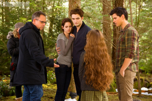 "Bill Condon with cuddling Kristen Stewart and Robert Pattinson, Mackenzie Foy and Taylor Lautner on the set of ""The Twilight Saga: Breaking Dawn, Part 2,"" coming to Blu-ray and DVD on March 2."