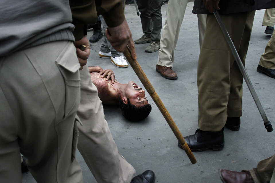 A government employee shouted as policemen beat him during a protest in Srinagar, India, Wednesday. Police used force to stop government employees during a protest called by a union to demand regularization of contractual jobs and salary increases. Mukhtar Khan/Associated Press