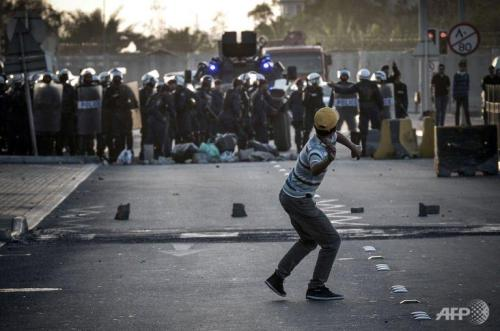 "Teenager dies during opposition protests in Bahrain on second anniversary of uprisingFebruary 14, 2013 Bahraini security forces have fired teargas, rubber bullets and birdshot at demonstrators hurling rocks and Molotov cocktails in street battles that left one teenager dead and dozens more people injured on the second anniversary of the country's failed pro-democracy uprising. The main opposition group, al-Wefaq, said 16-year-old Ali Ahmed Ibrahim Aljazeeri died from his injuries about an hour after being shot early in the morning in the village of Diya, near the capital Manama. ""He was shot with three rounds from a birdshot gun and died of critical injuries to the upper body and lungs,"" the group said. ""Witnesses confirm he was posing no threat to any police officers at the time."" Dozens of other people were also hurt in the violence, al-Wefaq said, some by teargas and others more seriously. It posted pictures online of some of the wounded, including a photograph of the dead youth with bandages on his stomach. It accused the Bahraini authorities of deploying ""large numbers of armoured vehicles, police cars and buses, convoys of military vehicles and troops … to face peaceful protests demanding freedom and democracy"". Dozens of videos posted by activists showed groups of youths setting up roadblocks and barricades and hurling stones and firebombs at security forces, who responded with teargas. Bahrain's chief of public security, Major General Tariq Hassan al-Hassan, said in a statement that the death came after a group of some 300 rioters attacked police ""with rocks, steel rods and Molotov cocktails. Warning shots were fired but failed to disperse the advancing crowd who continued their attack. Officers discharged birdshot to defend themselves."" Hassan confirmed ""at least one protester was injured"" and ""a short time later, a young man was pronounced dead at [the country's main hospital] Salmaniya Medical Complex"". He warned the public not to try to ""exploit the death for political purposes, or as an excuse to engage in criminal or riotous behaviour"" and insisted most areas of the country were calm and traffic was flowing freely in Manama. Bahrain has seen almost daily protests since the mass protests of 14 February 2011. Demonstrators want greater rights for the country's Shia majority and an end to the absolute power of the ruling Sunni al-Khalifa dynasty, which picks all key government and military posts. Opposition demands for far-reaching reform include a constitutional monarchy and an elected prime minister to replace Prince Khalifa bin Salman al-Khalifa, who has held the job since independence in 1971 and is an uncle of King Hamad. The government denies discrimination against Shias. The violence could derail reconciliation talks that resumed last weekend between al-Wefaq and other, mostly Shia Muslim, opposition groups and Sunni envoys. Alistair Burt, the UK foreign office minister, said on Twitter it was ""important everyone remains committed to the national consensus dialogue – it's the only way to promote peace and stability in Bahrain"". But one prominent activist, Ala'a Shehabi, said the protests showed the irrelevance of the government's dialogue initiative. ""The majority of Bahrainis really just want to live in basic dignity and freedom,"" Shehabi, founder of the campaign group Bahrain Watch, told the Guardian. ""They don't believe the current royal family is willing to deliver that."" Shehabi said the opposition was sceptical about the national consensus dialogue because no senior members of the government or royal family are involved. ""To the youth on the street, the dialogue initiative is irrelevant. Even opposition members who have taken part stress the importance of the street protest movement. There is so much scepticism about the sincerity by the government over these talks that no one is really taking them seriously."" An international inquiry said 35 people died during Bahrain's uprising; the opposition puts the toll at more than 80. Amnesty International has called for the Bahraini authorities to release political prisoners, lift restrictions on freedom of expression and prosecute security force members responsible for human rights abuses. Its Middle East and North Africa deputy director, Hassiba Hadj Sahraoui, said the government ""cannot carry on imprisoning people simply because it can't take criticism. It's time that people detained simply for exercising their right to freedom of expression be released and for the harassment of other activists to desist."" Source"