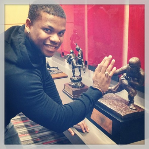 High-5ing Archie Griffin's Heisman Trophy.