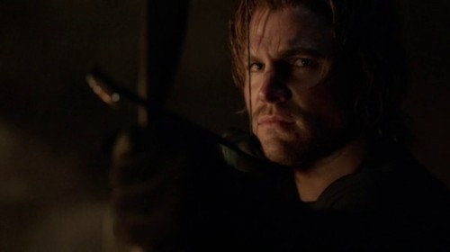 Arrow Ep 1.23 'Sacrifice' is an entertaining, somewhat satisfying finale With a title like 'Sacrifice', there was no denying that someone was going to die in tonight's episode. And although 'Sacrifice' tries to get clever with a few expected misleads (one that lands really well), Arrow decides to eliminate the easiest option – but one I wished they hadn't, for reasons I'll explain later. But with the wonky character development pushed to the side, 'Sacrifice' sets its sights on one event, and executes it with confidence, keeping things moving even when some of the emotions fall flat. Unfortunately (a phrase I feel I use often on this show), the island material for the season culminates a single explosion, a fitting end for what was largely an empty parallel to Oliver's adventures in Starling City. There were occasional attempts at trying to ground Oliver's emotions in his experiences on the island, but these didn't really add up to much, thanks to the convoluted double and triple-crossing characters and large sense that people were running in circles. And that's what the ending feels like: as Yao Fei lies dead on the ground, Oliver breaks the three of them free, and they take out the entire camp by re-routing one of the missiles right back into the camp (apparently re-routing consists of unplugging and replugging a single wire). Then Oliver kills his first man with an arrow (the dickhead general who had a lot of time on-screen, but never amounted to much), and that's the end of the island material, for this season. Hopefully season two will accelerate oh… four years forward in the island timeline, and we can start with Oliver learning Russian and becoming part of the mafia (remember that?). CLICK HERE TO EXPAND THE ARTICLE