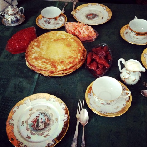 Maslenitsa pancakes with caviar, salmon and candied fruits tea party at grandma's home