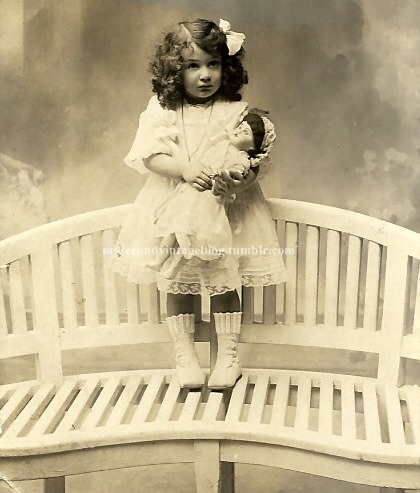 mysecondvintageblog:  little girl with doll