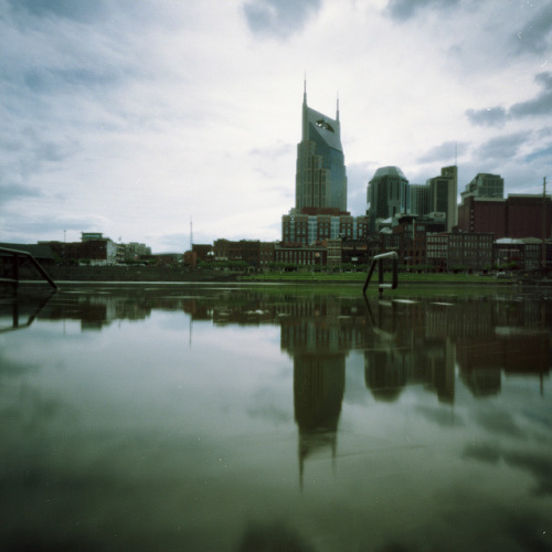 Pinhole: Half Empty on Flickr.Downtown Nashville skyline. Half of it, at least. The water was up from a few days of rain. Zero Image 6x9, f/235, Kodak Portra 100T, about  10 seconds