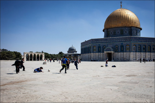Young boys play soccer in front of the Dome of the Rock Jerusalem, Israel March 25th 2013