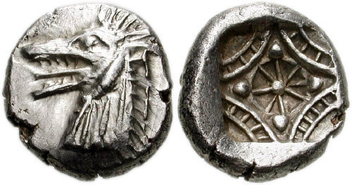 archaicwonder:  Sea Monster coin of Kindya, Caria c. 510 -490 BCOn the obverse of this tetrobol is the head of a ketos (sea monster) with its tongue protruding. On the other side is a stellate pattern within a latticed frame, all within an incuse square. In Greek mythology, both Perseus and Herakles killed a ketos (Latin cetus). When Cassiopeia boasted that her daughter Andromeda was more beautiful than the Nereids, this invoked the wrath of Poseidon who sent the sea monster Cetus to attack Æthiopia. Upon consulting a wise oracle, Cepheus and Cassiopeia were told to sacrifice Andromeda to Cetus. They had Andromeda chained to a rock near the ocean so that Cetus could devour her. Perseus found Andromeda chained to the rock and learned of her plight. When Cetus emerged from the ocean to devour Andromeda, Perseus managed to slay it. In one version, Perseus drove his sword into Cetus' back. In another version, Perseus used Medusa's severed head to turn Cetus to stone. Caria was located coastal region modern day Southwestern Anatolia, Turkey.
