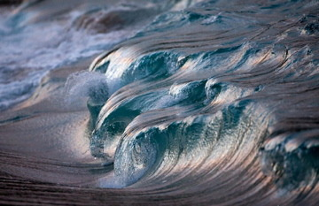 "devidsketchbook:  PHOTOGRAPHER PIERRE CARREAU ""Fascinated by the ocean, photographer Pierre Carreau is naturally drawn to the study of waves, their essence, their movement, and their shape. All of his work features the energetic life of the ocean as it crashes onto the shores, with every painterly shot more unique than the next. Carreau believes his photographs mix power with fragility and he says, ""I like the fact that this energy comes from far away to be revealed on our beaches."" Carreau is able to document the beautiful light and shadows that shine along the surface of the water, producing what appear to be delicate pieces of glass that viewers will want to reach out and touch. Capturing such perfect moments takes a lot of work, and the artist finds that he needs to take hundreds of photographs to get exactly the right moment. But, as we see in his collection of what he calls ""liquid sculptures,"" the hard work is totally worth it as he successfully brings to us the stunning, crystal-clear details and transparency of the powerful ocean waves."" [via: leslieseuffert]"