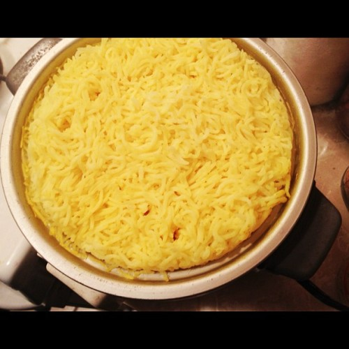 How to make yellow turmeric rice: cook 1 cup rice w/ 2 cups water & 1/3 teaspoon turmeric mixed in (at Home)