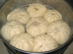"sinophilia:  RISE AND SHINE, IT'S BREAKFAST TIME! - PART 2 Mántou(馒头) and Bāozi(包子) (Hot buns)  If you're just craving some good old-fashioned bread, look no further than a stand selling mantou…… or baozi…..Mantou is a steamed block of dough that dates back to the Qin dynasty (220 B.C.). The real pleasure of feasting on mantou comes with its necessity to eat it with your hands.Baozi essentially is the evolution of mantou and is another steamed bun. Their sizes vary. Xiaobao (小包) are only about 3 cm in length and are typically eaten with chopsticks. Dabao (大包) are larger, up to 10 cm. The only caution with these breads is to be wary of surprises. You never know when you'll encounter ""surprise"" meat, red bean, vegetables or rice. Variations of baozi can be seen regionally within China, including Tianjin's 狗不理包子(gǒubulǐ bāozi) and Shanghai's 小笼包 (xiălóngbāo).  Want to make your own mantou or baozi? Start kneading with a recipe HERE.  Tomorrow, we will continue exploring the Beijing breakfast with: Fried bread and soy milk - yóutiáo (油条) and dòuzhī (豆汁).  See all posts in the RISE AND SHINE, IT'S BREAKFAST TIME! series HERE.  (Serialized from THE WORLD OF CHINESE)"