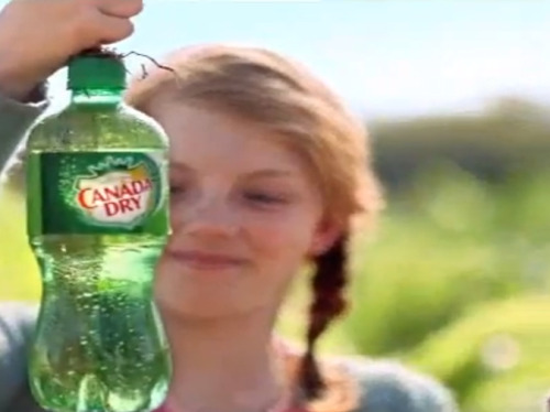 "Excerpt from ""The Canada Dry Girl"" Documentary Interviews, Central Florida, 2013. Carrie Newgent, 29 years of age, 248 lbs. Interviewer: What do you say to people who worry that the…drink… you're drinking. The ginger ale. Might have…addictive properties? Carrie Newgent: [Laughs] It's ginger ale! Soda. Same as they drink everywhere in the world. Same as you get at the supermarket or the 7-11 or a baseball game. Here [holds out a soda], give it a shot. Interviewer: I don't… CN: It's soda pop! Interviewer: Some people say the field…that there are qualities. CN: The field? [Gestures behind her] Its dirt and ginger. You can see that for yourself. You can go over there stick your thumb in it if you like. Plenty have done it. Interviewer: But this is the only place in the world where those two things – ginger and dirt is what I mean. Where they combine to produce manufactured ginger ale. In plastic bottles. Bottles that have been confirmed to contain no organic materials. CN: Well. Are we talking about, I mean, are you asking about the soda or the field or us or the girl? Interviewer: I'm asking about all of it, I suppose. CN: Well. [Finishes can of ginger ale]. Maybe what you want to be asking about, then, is the girl.  (via Hobart :: Canada Dry)"