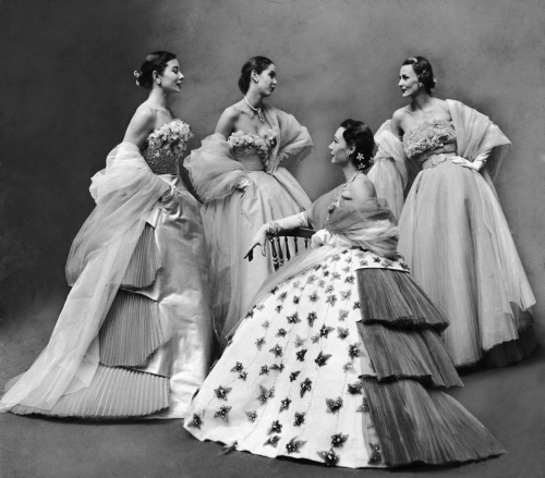 Gordon Parks: Models showing off five fabulous ball gowns designed by Jacques Fath at fashion show. Paris, France, 1951