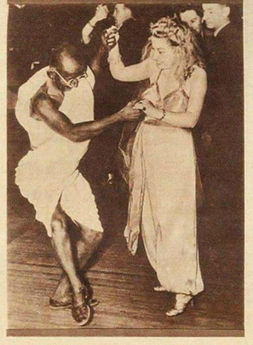 Real or not this is still a badass photo! Ghandi dancing with Queen Elizabeth