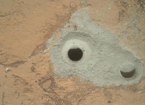 NASA's Curiosity rover has bored a 64mm-deep hole into a flat veiny patch of fine-grained sedimentary Martian bedrock for samples, which will be analysed onboard for evidence about long-gone wet environments. This is the first time we've drilled for samples on Mars.