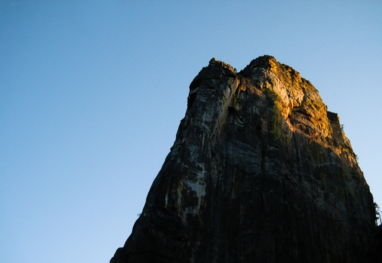 "East Buttress, Middle Cathedral Rock [April 2013] Flashback of the Epinephrine descent dazzled me as we raced the dying ray to find our first rappel anchor. Looming ahead of us, the Higher Cathedral Rock was soaked in beautiful alpenglow - a sight that struck serenity in our souls but fear in our minds. A shadow was moving up the façade steadily like an inverted hourglass, consuming it mercilessly into the void. We managed to find the bolts minutes before we needed to turn our headlamps on, and rappelled down a wet gully in the dark. [[MORE]] This may be new to the other guys but I am used it by now, for better or worse. The East Buttress of Middle Cathedral Rock was a very enjoyable route, and it was no surprised to earn a spot on the fifty ""crowded"" classic climbs of America. Despite the traffic jam and heinous descent, I would definitely recommend it.  Perhaps I will come back again for some unfinished business, maybe after getting better at face climbing. If you know the route, you will know what I mean. After making two more raps, we slogged down what appeared to be an bottomless boulder alley. Occasionally I would turn my light off and gazed up the starry sky. It put my mind to ease, and reminded me of why I chose to be here instead of my comfortable bed. Then I would turn around and see three white dots moving in unison, just like the night I spent coming down from Mt. Whitney. Oh good times. It's funny how, sometimes, the most memorable part of a route is not the route itself. The stranger whom you shared the first belay ledge with could end up being a life-long friend. Or the moments when you found the courage to overcome your fear and pushed on. There are times when things don't go as planned but that is what adventure is all about. The key is to stay focused and don't let your weakness manifest yourself. To an outsider, it may be nothing more than a story over beer and campfire. To me, nothing matters more than the bonds that were strengthened through this ordeal, because we lived through it, together.  Assis coming up the crux pitch on the East Buttress of Middle Cathedral Rock The incredible view of El Capitan literally across the street Michael took some pretty cool shot of us from the road, hope he recovers soon and join us in our next [epic] adventure (Arrow is pointing at Parker, looks like I am halfway up the pitch)"
