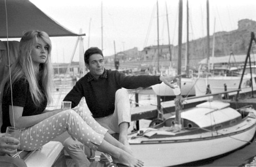 "Brigitte Bardot and husband Jacques Charrier christen their new boat ""Le Babette"" with champagne, June 1959."