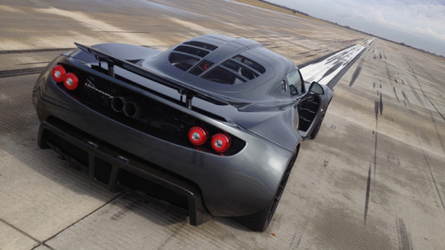 topgear:  Venom GT sets new world record It's official: the Hennessey Venom GT is the fastest car to accelerate from 0-300km/h… in the world. You already knew the Texan-built FrankenLotus was a little bundle of unholy firepower, but now the dinky nuke has burned its name into the record books. Specifically, the Guinness Book of World Records; a representative was officially on hand during a record-run along Ellington Field in Houston to clock the Venom's raucous acceleration. The GT, powered by a twin-turbocharged 7.0-litre aluminium V8, took just 13.63 seconds to hit 186mph. That's not quick, that's Quick.