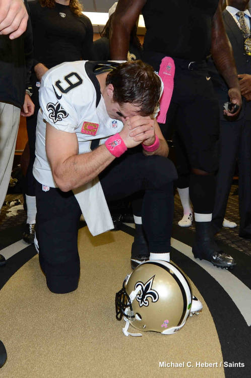 New Orleans Saints QB Drew Brees takes a knee after the Saints-Chargers game on Oct. 7. 2012. Brees set the NFL record for most consecutive games with a passing touchdown at 48 games.