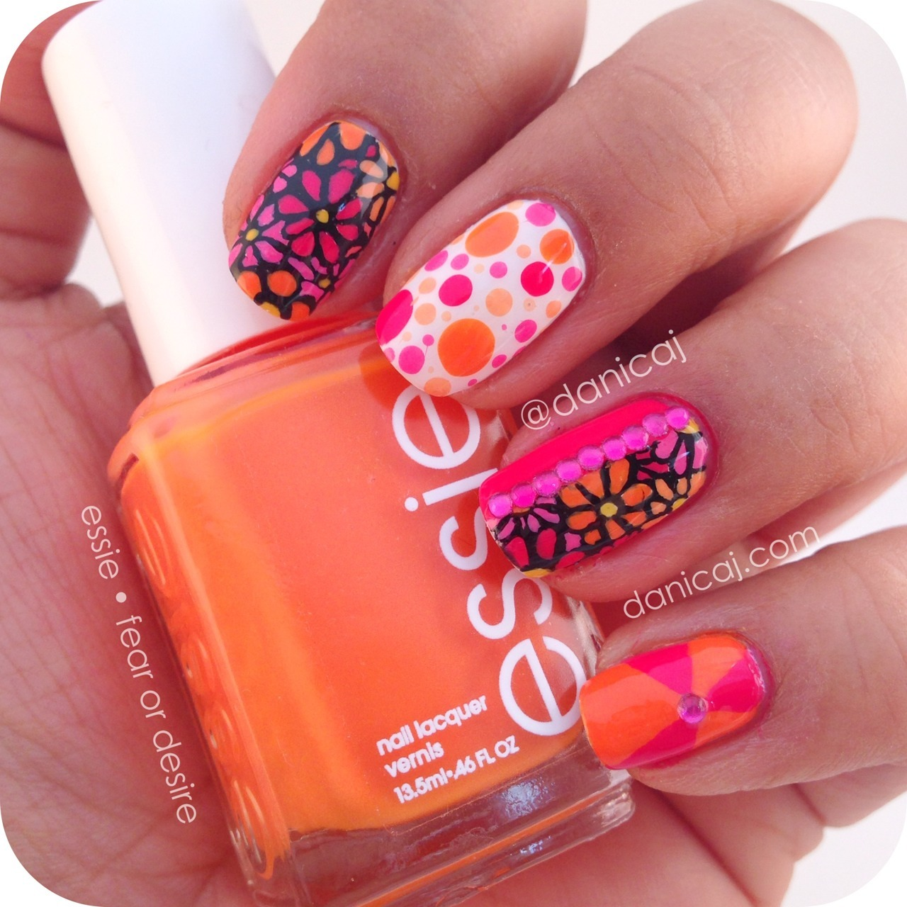 You can't tell me this isn't fabulous! Mix n match mani filled with hand painted florals, dots, and rhinestones! Come on summer, where you at!?