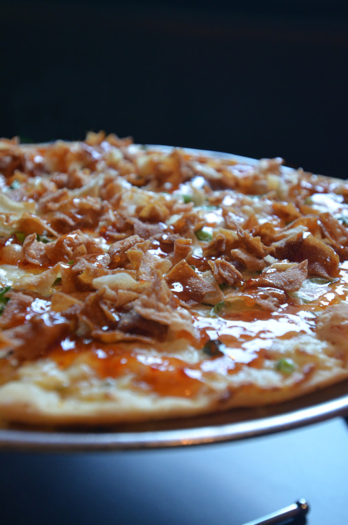 On Location: Fong's Pizza / Des Moines, IA Crab Rangoon Pizza » Crab rangoon base, surimi, green onion, asiago and mozzarella topped with crispy egg roll strips and sweet chili sauce.