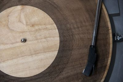 "Laser-Cut Wooden Records Give New Meaning to 'Tree Rings' or 'Organic'. ""Amanda Ghassaei, creator of the 3-D printed record, is at it again, this time with lasers. Diverting from additive manufacturing to subtractive, Ghassaei etched tracks on another medium — wood — using a 120-watt Epilog Legend EXT laser cutter. The strains of Radiohead's ""Idioteque"" and The Velvet Underground's ""Sunday Morning"" are easily recognizable, but infused with an almost electric whine, a strange sound to hear emanating from a piece of wood. Ghassaei is a software engineer at Instructables, so she naturally published a how-to on the DIY site."""