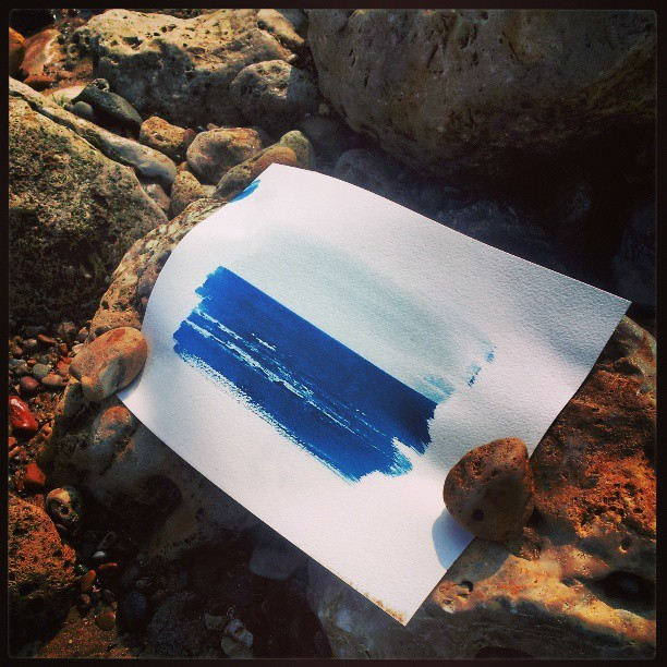 Beccas cyanotype print devoping in the tropical 9degrees at the beach.