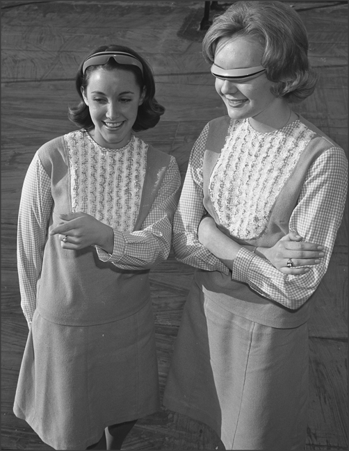"Teen Fads, 1956 DOUBLE DUTY-Sue Manders, right, and Lynn Grossman try out the new ""Boy Watcher"" glasses that may look like an outer space accessory but in reality double as a hair retainer and ""specs"" that let a girl stare discreetly at any young man. via"