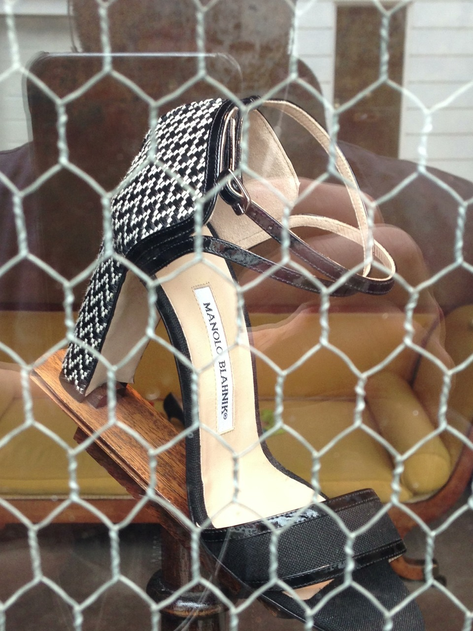 Manolo Blahniks behind chicken wire in London's Chelsea. A metaphor. For something.