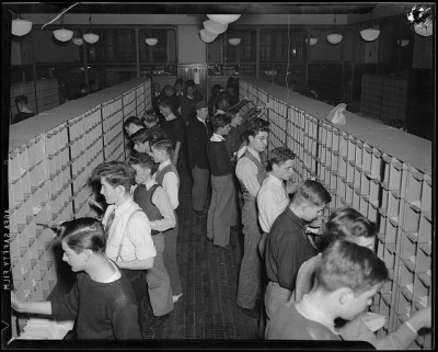 Sorting mail during Christmas rush, South Station Postal Annex by Boston Public Library on Flickr.And I'm here,looking at this picture and waiting - sad - for my box with Christmas nonpareils sprinkles :(