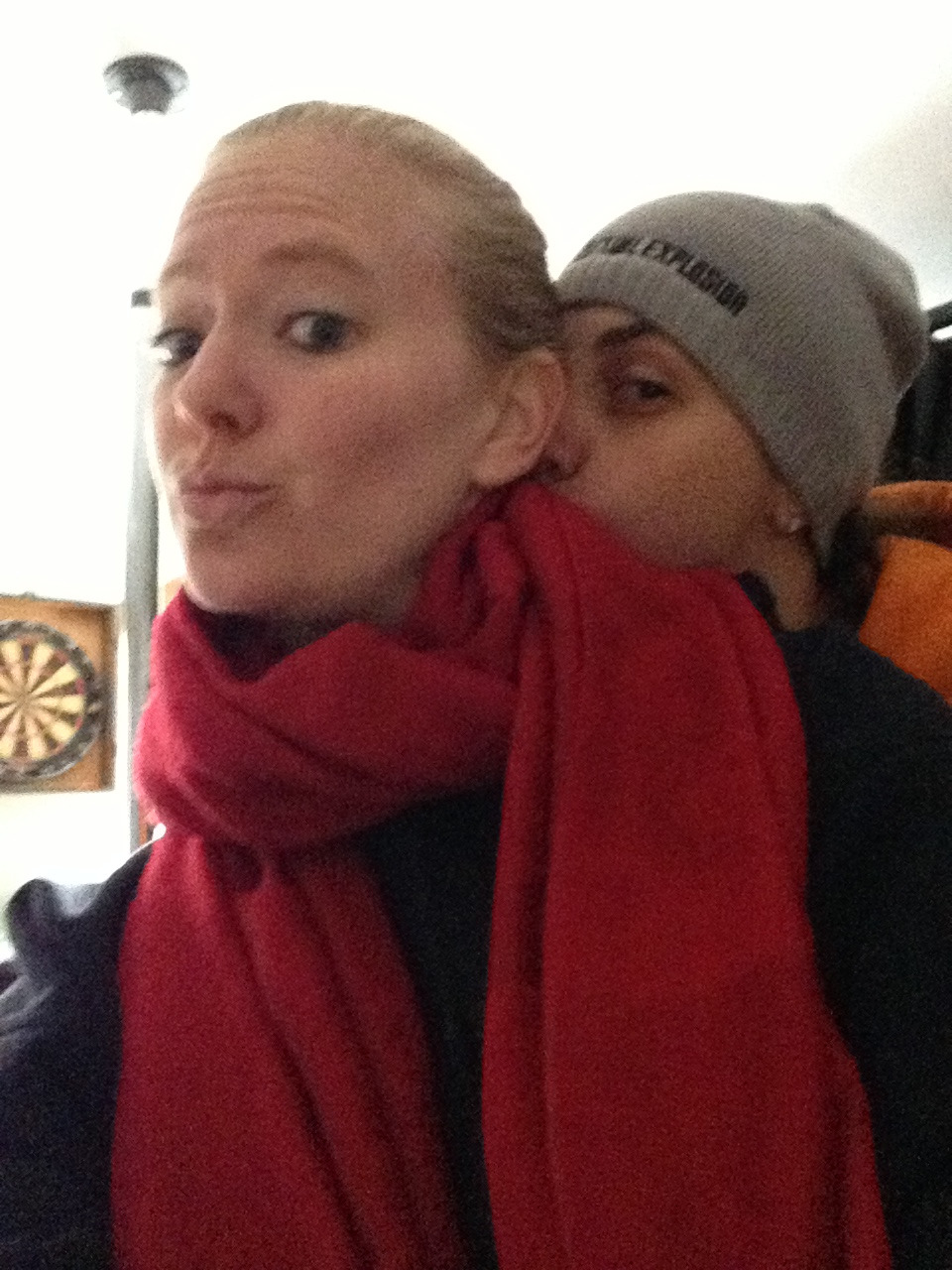 Stealing a friends scarf while my girl steals a kiss