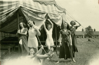 killerbeesting:  A group of female dance students pose for a picture in front of a striped tent at Bennington College in Bennington, Vermont.  1938