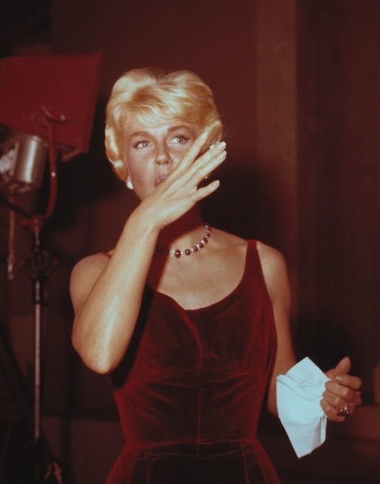 theniftyfifties:  Doris Day licks frosting off her fingers during her birthday/anniversary celebration on the set of 'Pillow Talk', 1959.
