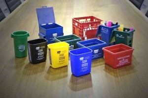 "What better way to promote your recycling program or recycling service than through the use of mini carts and bins? These promotional items are always a hit at tradeshows, are great for sales calls and can be customized to put your company logo and contact information on the desk of anyone you give them to. Best of all, these handy items come in different colors and different designs, so it's easy to find the one that's right for you. If you are a college or university looking to promote recycling on campus, then consider a campaign whereby you give away mini recycling bins with your school logo along with a slogan like ""We Recycle!"". It's a popular way to promote a campus recycling program and helps get the word out about your school's sustainability efforts. If you are a business providing a recycling collection service, what better way to let people know about your service than by giving them a mini recycling cart with your contact information right on the mini bin? Every time your prospect reaches for a pen or highlighter in their mini cart, your company information will be prominently displayed. If you are a municipality or city looking to increase recycling rates and spread awareness about your collection program, think about distributing mini recycling bin key chains to help spread the word. Everyone loves free items. When those items are interesting and practical, they tend to love them even more. If you can get your name onto items like this, it's a great way to promote your program or service. When it comes to mini recycling bins, what's not to like?"