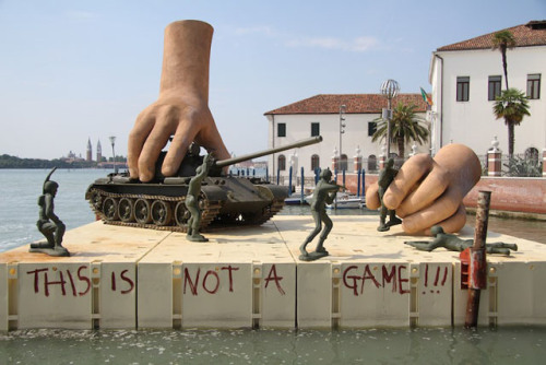 laughingsquid:  This is Not a Game, Sculpture of Giant Hands Playing with Life-Sized Tank and Toy Soldiers
