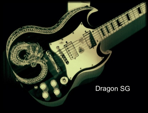 Dragon SG. We've featured Chris Martin and his Piccywood guitars before, and the designs just get more and more awesome. This effect is made using pyrography, where you burn the image into the wood itself. Check out his website for more info.