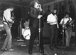 "dynamitehemorrhage:   PERE UBU certainly haven't shied away from putting their archival material online, and there are some fantastic sets available for you to purchase here. I've had this tape for many years of their May 5th, 1976 show at The Mistake in Cleveland, Ohio – and it looks to me like it's not something available online anywhere else. If you believe this page, it may have only been their 7th show ever. Another recording from a month earlier at the exact same venue came out as the CD ""The Shape of Things"" - and it's tremendous. As is this. It's early, raw, primal Ubu inventing a blend of punk rock and modern art never before or since seen. Enjoy. Download PERE UBU – Live at The Mistake, Cleveland, 5-5-76 Track Listing: Intro Heart of Darkness Cloud 149 Street Waves Thirty Seconds Over Tokyo Life Stinks Final Solution Pushin' Too Hard Over My Head  Crucial Stuff."