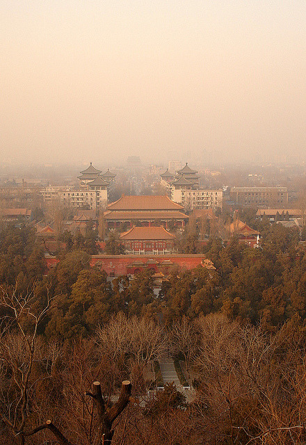 lerevel:  Forbidden City Beijing by TRAVEL4VITALITY on Flickr. Via Flickr: The Forbidden City was the Chinese imperial palace from the Ming Dynasty to the end of the Qing Dynasty. It is located in the middle of Beijing, China, and now houses the Palace Museum. For almost five hundred years, it served as the home of emperors and their households, as well as the ceremonial and political centre of Chinese government. source: Wikipedia TRAVEL4VITALITY | Blog | Twitter | Facebook  This actually isn't the forbidden city… It's a shot of jingshan park, the park directly north of the forbidden city on the central axis of beijing. It's a giant hill that was built from the earth removed to build the moat around the forbidden city.  If you turned 180 degrees from this point, THEN you would be looking at the forbidden city… But you can tell it's looking the wrong way because instead of seeing qianmen and the government buildings, you can see the drum and bell towers in the background.
